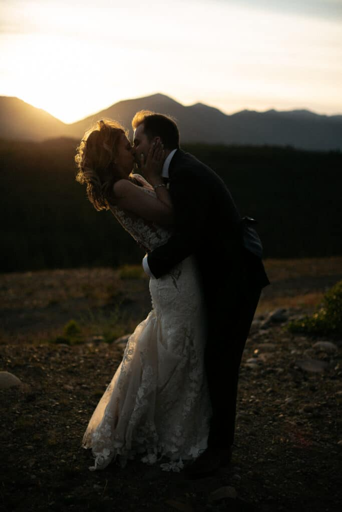 couple kisses in the sunset during Suncadia resort wedding in Cle Elem Washington.