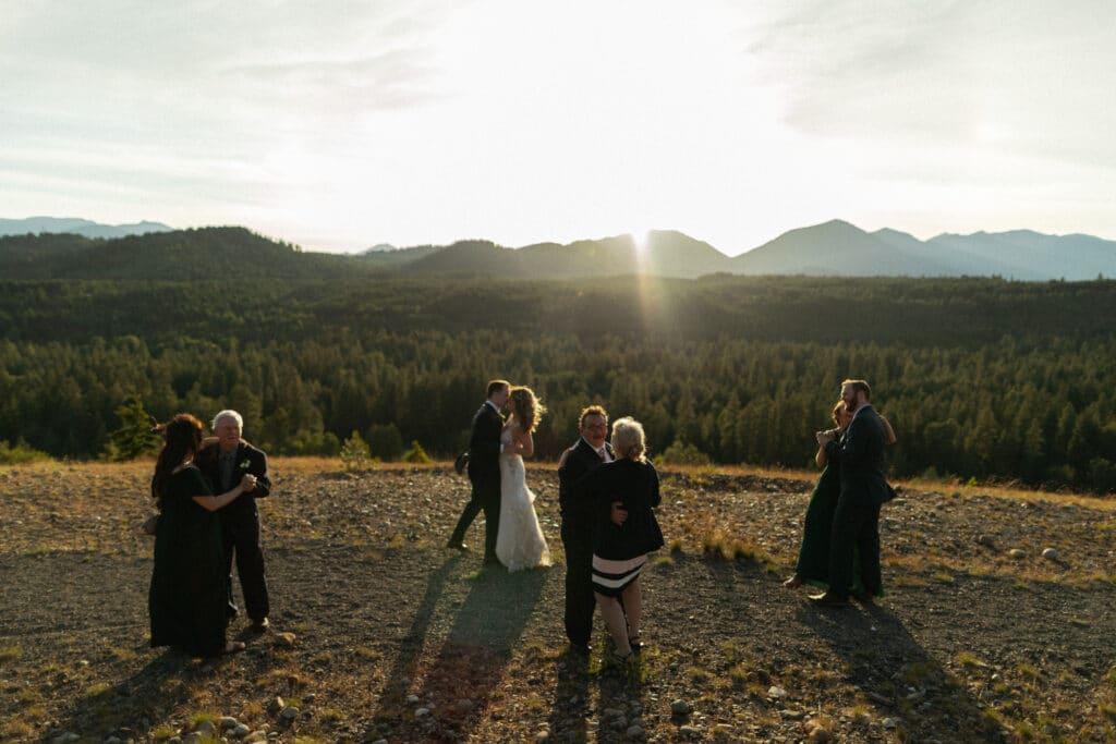 group first dance at sunset during Suncadia resort wedding in Cle Elem Washington.