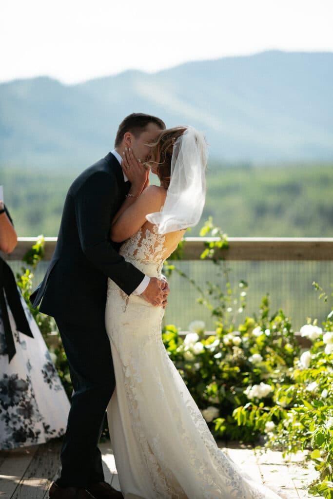 first kiss at Suncadia resort wedding in Cle Elem Washington.