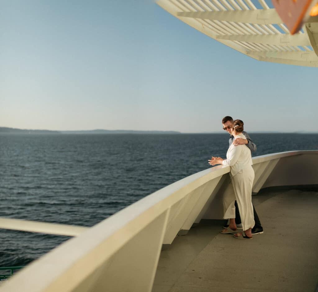 couple laughs together during bainbridge island ferry wedding at sunset