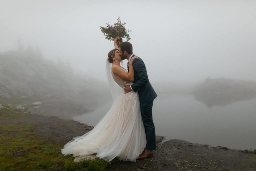 first kiss during artist point wedding at mt baker