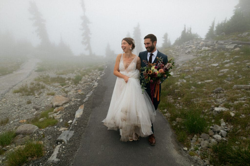 bride and groom laugh after artist point wedding