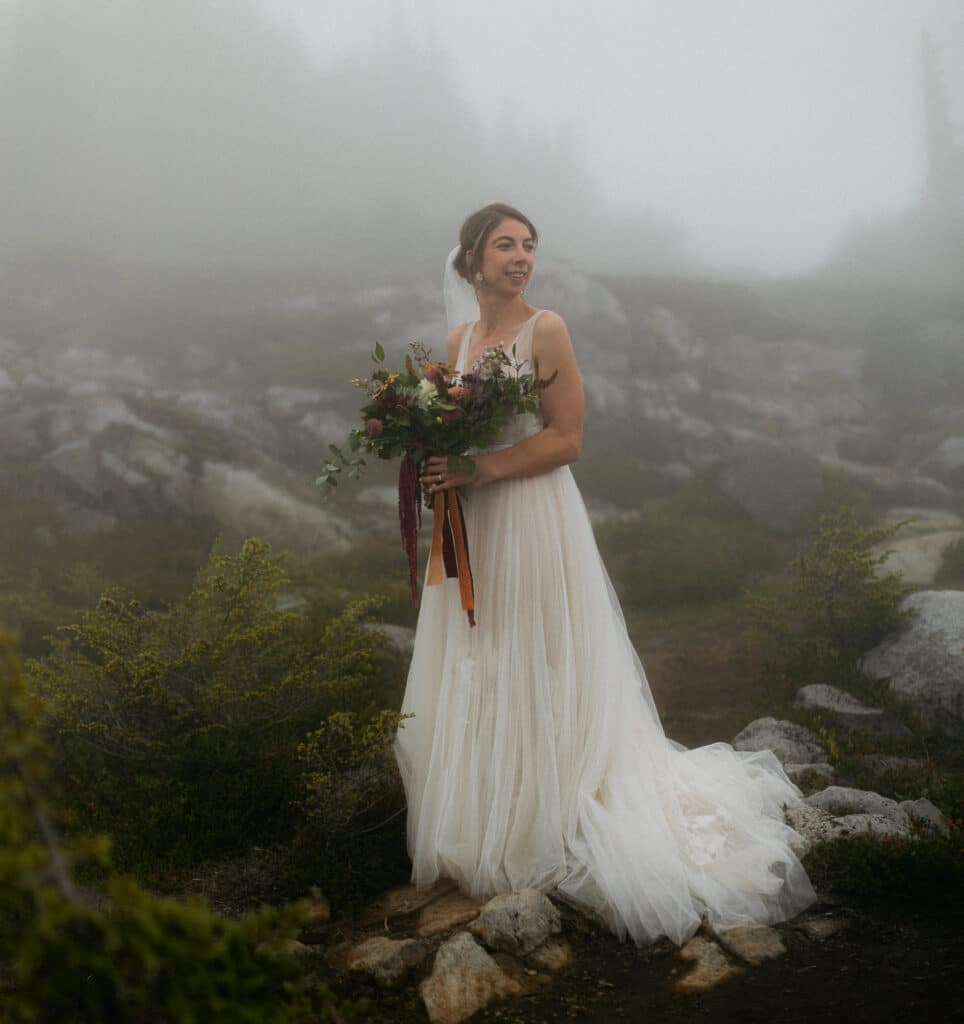 bride stands together in the fog for her artist point wedding in the north cascades
