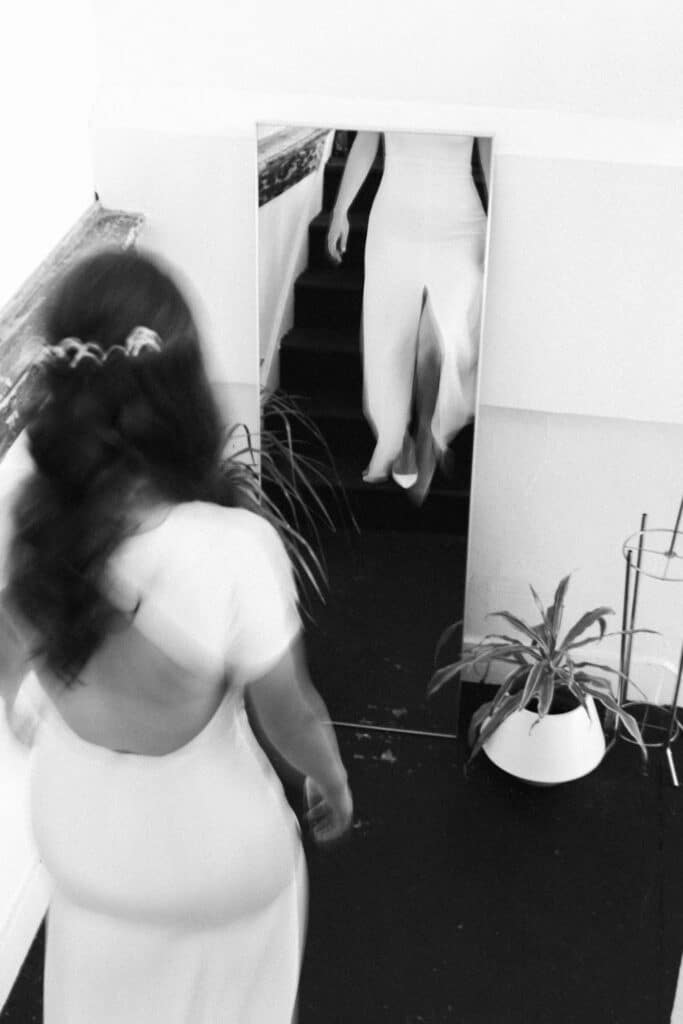 bride walks down the stairs during olympic sculpture park wedding in seattle