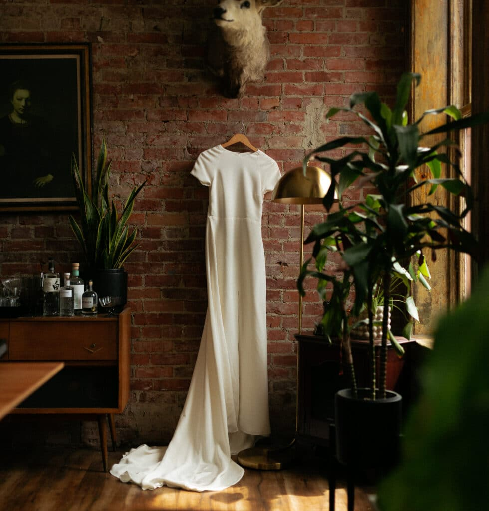wedding dress hangs on the wall during olympic sculpture park wedding in seattle