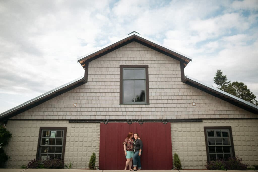 couple smiles outside brickworks in Friday Harbor on san juan island for their elopement